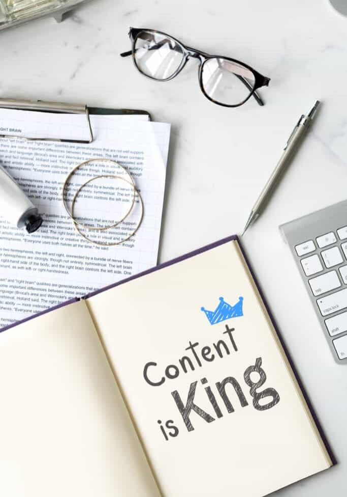 Content is king written on a notebook